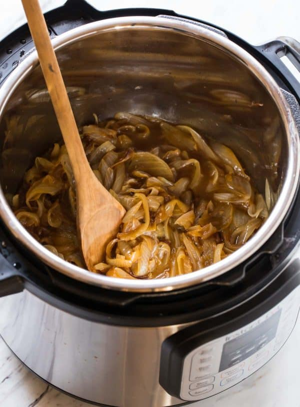 caramelized onions and a wooden spoon in an Instant Pot