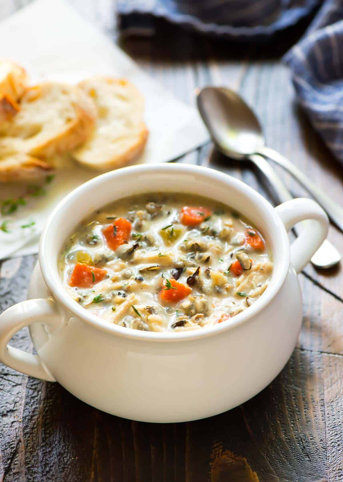 creamy chicken and wild rice soup (made in an Instant Pot), served in a white soup crock