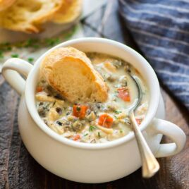 Slow Cooker Creamy Chicken and Wild Rice Soup in a soup crock
