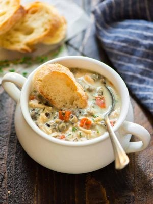"Slow Cooker Creamy Chicken and Wild Rice Soup. Easy, healthy recipe without the ""cream of"" soup. Tastes even better than Panera! Make in a crockpot or an Instant Pot."