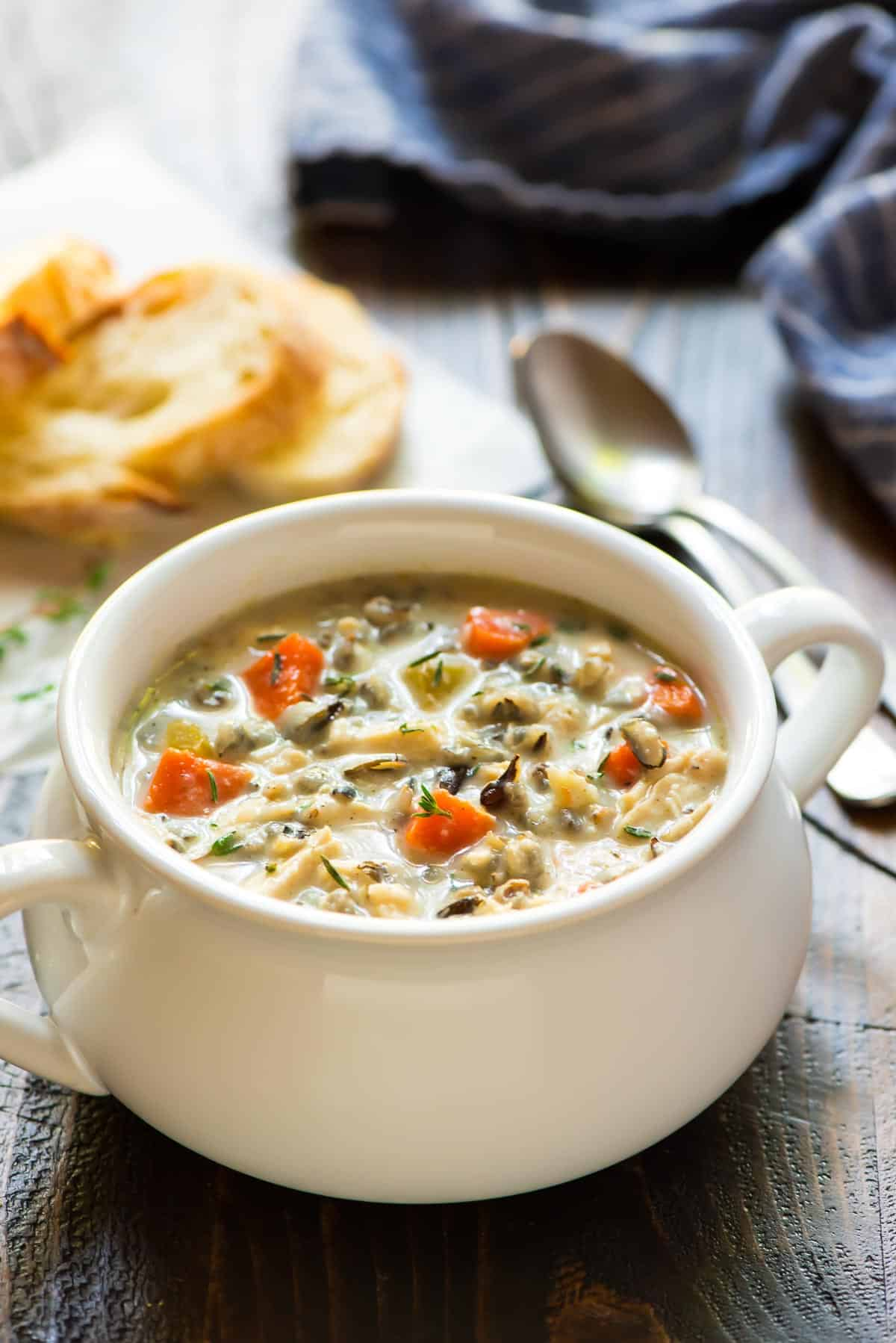 white crock of Creamy Chicken and Wild Rice Soup