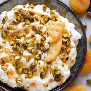 Creamy Honey Ricotta Dip with Pistachio and Apricot. Easy and delicious recipe served with bread and crackers. One of our favorite appetizers for parties!