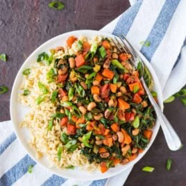 Easy Vegetarian Hoppin' John! A healthy twist on traditional Southern Hoppin' John that cooks in ONE PAN. Made with with rice, black eyed peas, and greens. Great for New Years or anytime you need a fast dinner recipe!