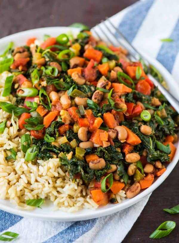 Vegetarian Hoppin John recipe with canned black eyed peas, rice, and greens. Easy, fast, and and healthy!