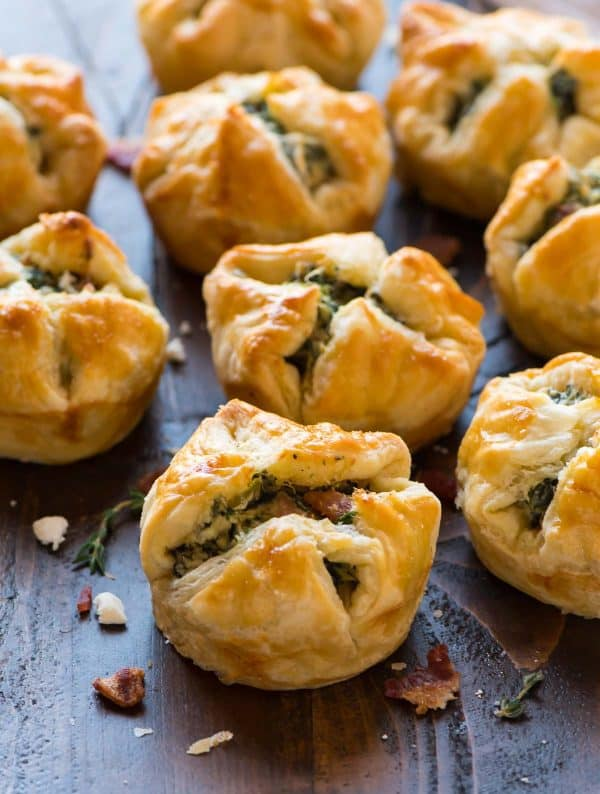 EASY Spinach Puffs. These cream cheese puff pastry cups are filled with cream cheese, spinach, feta, and bacon. The perfect holiday appetizer recipe!