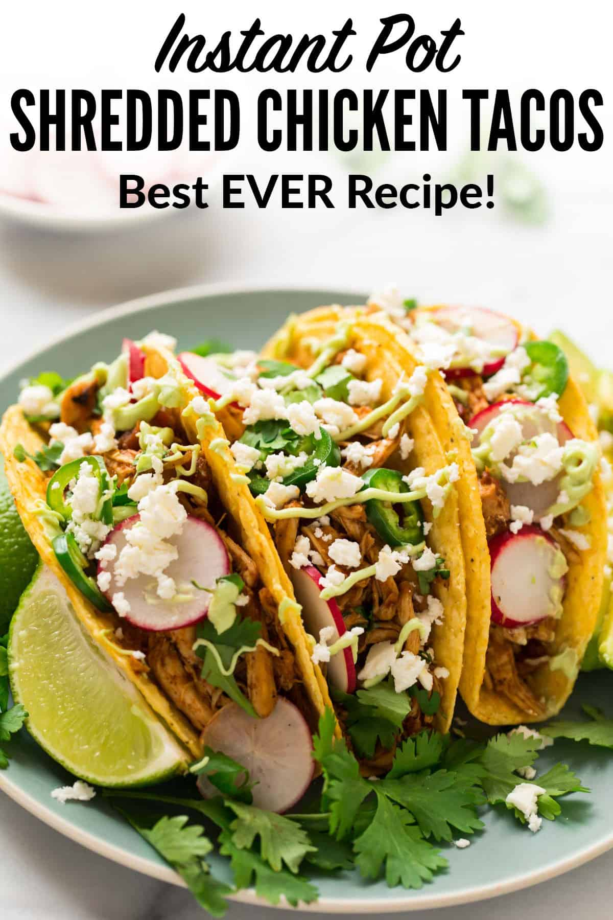 The BEST EVER Instant Pot Shredded Chicken Tacos! Easy, juicy pressure cooker Mexican chicken that's healthy and full of flavor. Use it for tacos, burritos, taco bowls, or mix with black beans and rice. #pressurecooker #instantpot #shreddedchicken #healthy