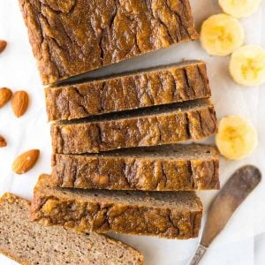 PERFECT Paleo Banana Bread with coconut flour, almond butter, and maple syrup or honey. This moist, tender banana bread tastes like the real-deal but is flourless and made with NO butter, NO oil and NO sugar! The best healthy banana bread recipe you will ever bake! #paleo #bananabread #easy #healthy