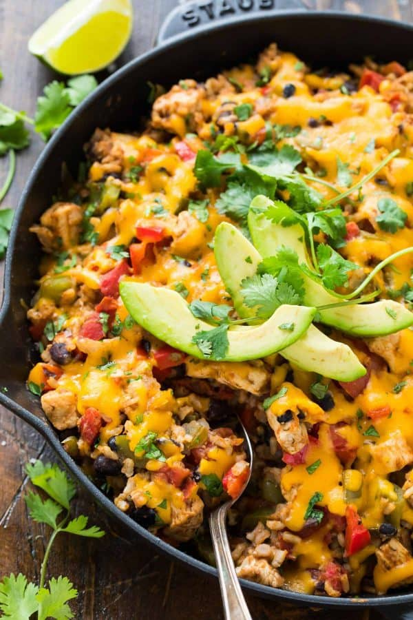 One Pan Fiesta Chicken and Rice. Cheesy, healthy, and PACKED with Southwest ranch flavor! Easy make ahead recipe that tastes great leftover. The whole family will love it!