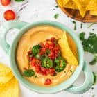 Mind-blowing Vegan Queso Dip. BEST EVER. I can't believe this is healthy! Made with roasted cauliflower, cashews, and nutritional yeast, you'll never believe this creamy queso blanco recipe doesn't have cheese!