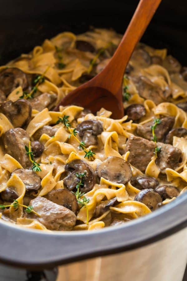 crock pot full of healthy beef stroganoff, made with Greek yogurt instead of sour cream
