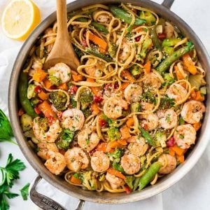 An easy, healthy Lemon Garlic Shrimp Pasta with Parmesan. Frozen stir fry veggies make this recipe extra quick with minimal prep. Ready in 30 minutes and a total crowd pleaser! Simple, lightly spicy, and perfect for date night or easy healthy dinners.