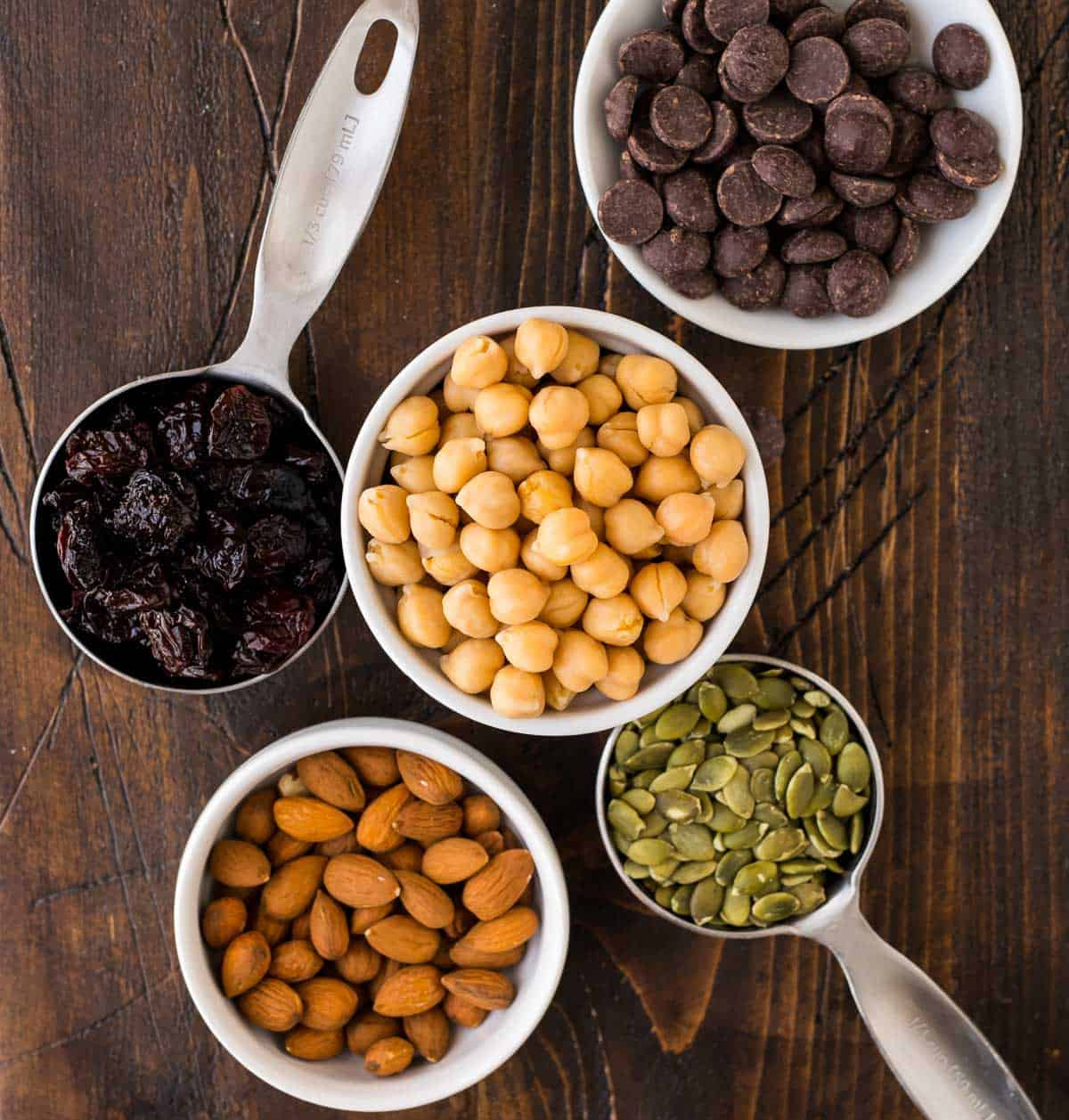 Roasted Chickpea Snack Mix. Make this easy, high-protein recipe for your next snack attack! Sweet roasted chickpeas with cinnamon are mixed with dried cherries, almonds, pumpkin seeds, and dark chocolate for a delicious treat.