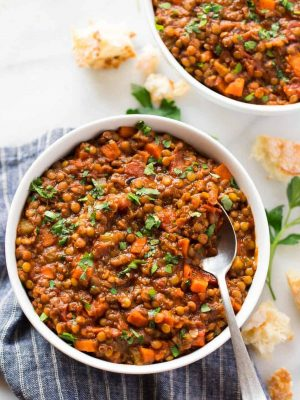 Instant Pot Lentil Soup - an easy, healthy recipe for French lentil soup made in the electric pressure cooker. So simple, hearty, and delicious! Gluten free, vegan, and freezer friendly. Recipe also includes stovetop method and tips to add ham or use red lentils or brown lentils instead. #healthy #soup #vegan