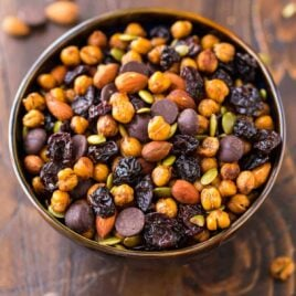 Roasted Chickpea Snack Mix – Crunchy cinnamon oven roasted chickpeas with dried cherries, almonds, pumpkin seeds, and dark chocolate. Sweet, spicy, and so addictive! Easy, packed with super foods, and high protein, it's the perfect on-the-go healthy snack recipe!