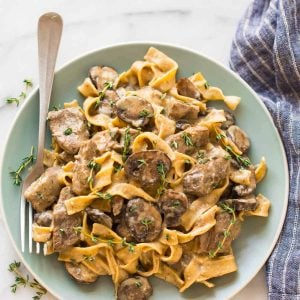 The BEST recipe for Slow Cooker Beef Stroganoff from scratch! Healthy version without the canned soup. EASY, creamy crockpot recipe with steak, mushrooms, and Greek yogurt instead of sour cream. Our whole family loves it!