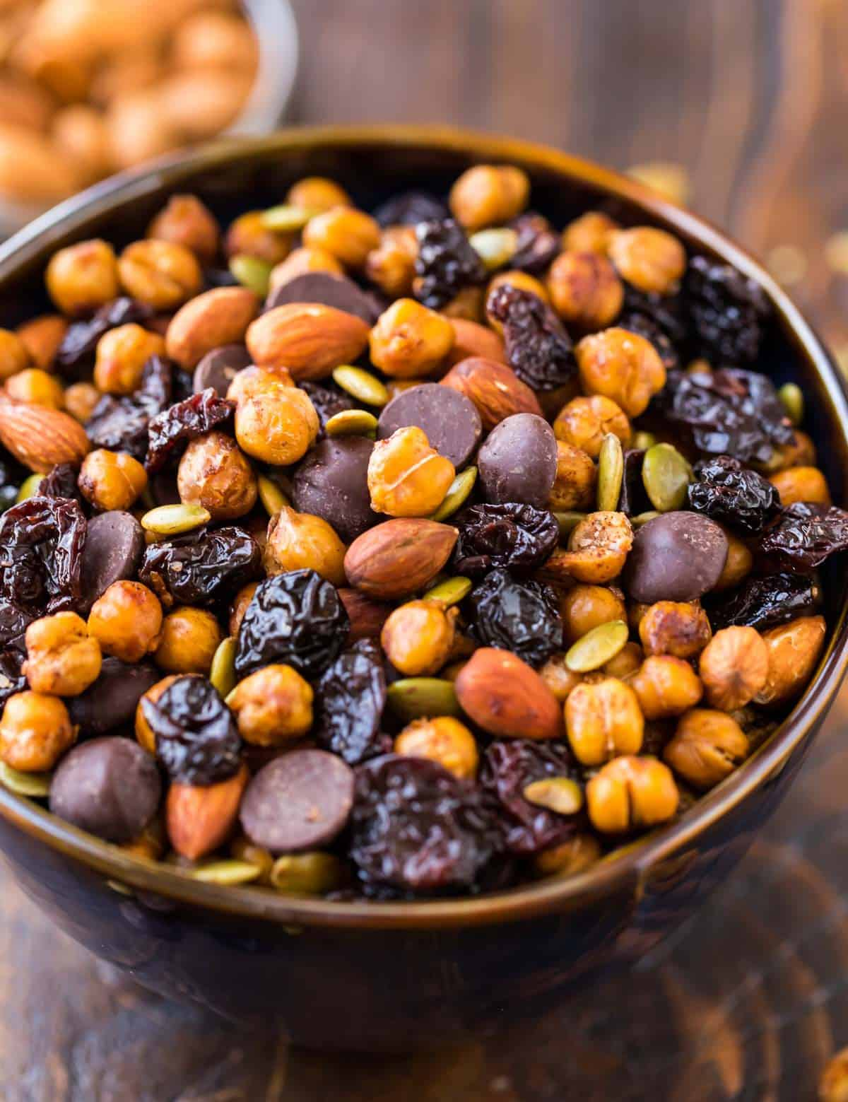 Easy Roasted Chickpea Snack Mix. This high-protein snack is perfect for afternoon snacks or workouts! Made with roasted chickpeas, cherries, almonds, and dark chocolate, it's crunch, sweet, spicy, and so addictive!