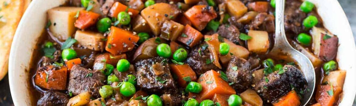 The BEST Crock Pot Beef Stew recipe ever! An easy, healthy slow cooker beef stew with fresh veggies, fall-apart tender meat, in a rich and flavorful red wine sauce. Simple, freezer friendly, and perfect every time.