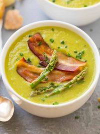 The BEST Healthy Cream of Asparagus Soup! This rich, velvety soup tastes like the Pioneer Woman's but is made without cream! Quick, easy recipe that's perfect for spring. Top with bacon or omit to make the asparagus soup vegan {gluten free; dairy free friendly}