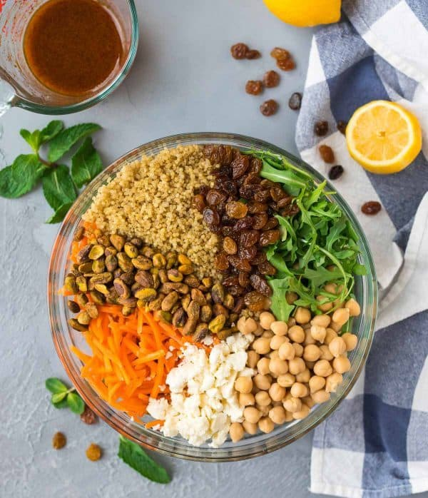 Healthy Moroccan Chickpea Quinoa Salad. Great for meal prep and lunches! Warm spices make this make-ahead version of Moroccan salad recipes easy and delicious.