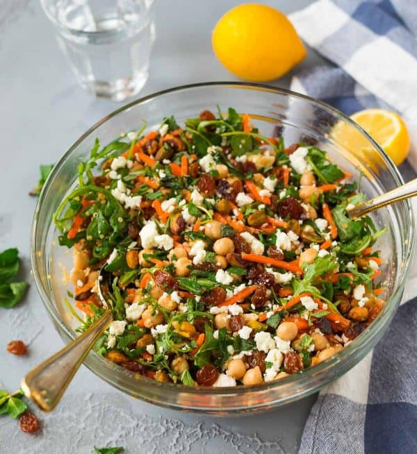 Easy Moroccan Chickpea Salad. Light, bright, and healthy, this salad is packed with carrots, quinoa, and arugula. Great for meal prep and weekday lunches!