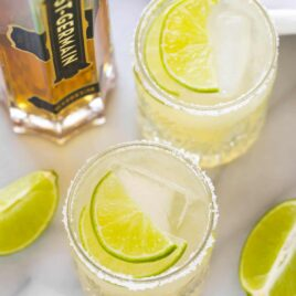 Two St. Germain margaritas with limes