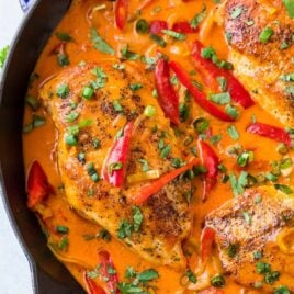 Easy ONE PAN Thai Chicken Curry with Coconut Milk recipe. Filled with authentic red Thai curry flavor, not too spicy, and the coconut milk sauce is to die for! Serve with rice for a fast, healthy weeknight dinner.