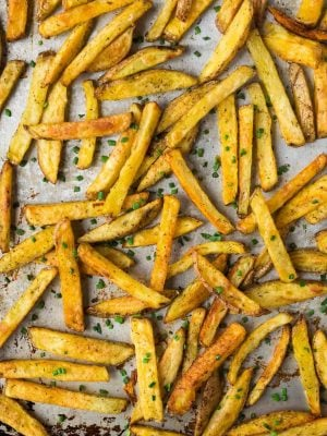 How to make Crispy Baked Oven Fries! Easy method that makes the most perfect, healthy French fries every time. Try this recipe with Garlic and Ranch or add any of your own favorite seasonings.
