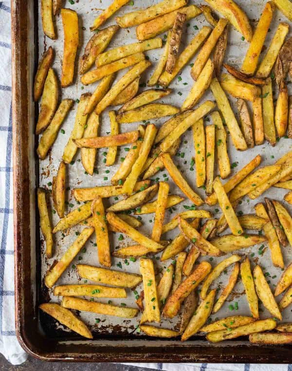 Crispy baked French fries with ranch seasoning on a baking sheet