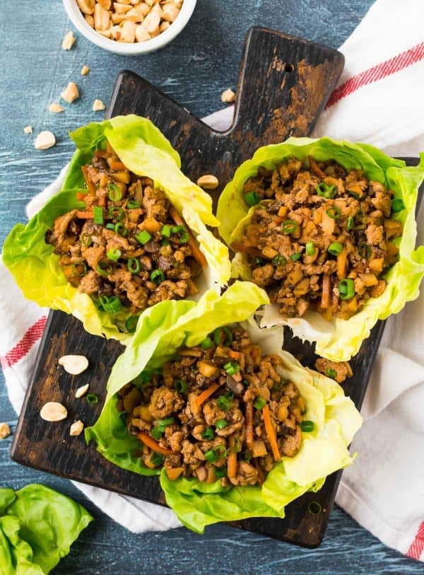 Healthy Crockpot Asian Lettuce Wraps with ground chicken or ground turkey, green onions, and fresh veggies. BETTER THAN PF CHANG'S! This fresh, healthy slow cooker recipe is so easy to make and the sauce is so flavorful and not too spicy. Serve with lettuce cups or rice for a delish low carb meal.