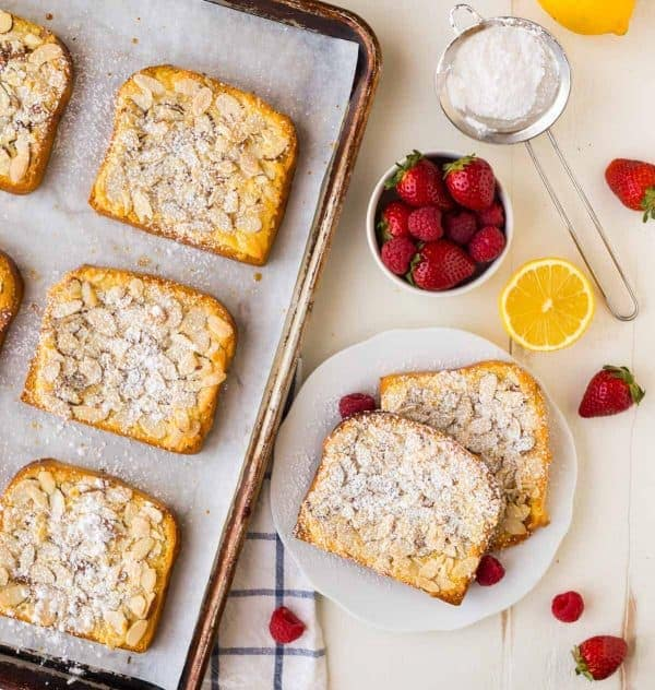 How to make Bostock pastry: Brioche soaked in syrup and topped with lemon almond cream, sliced almonds, and baked, brioche bostock tastes like the absolute best French breakfast toast you've ever eaten!