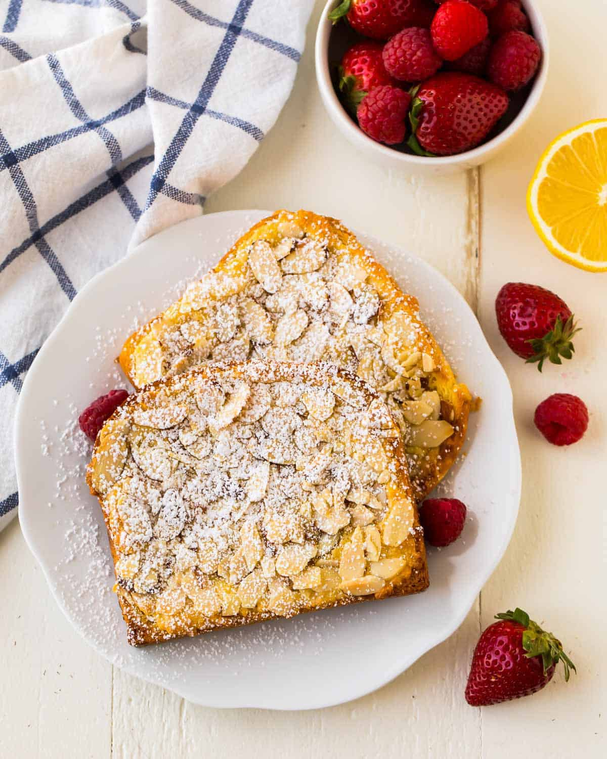 Thick slices of brioche bread topped with almond-lemon frangipane and baked to create a homemade version of bostock, a French pastry.