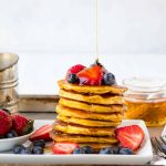 Fluffy low carb coconut flour pancakes! Light, tender pancakes made with coconut flour. High protein and easy to freeze for healthy breakfasts. Add banana, lemon, or any of your favorite toppings! #lowcarb #coconutflourpancakes #healthy #coconutflour
