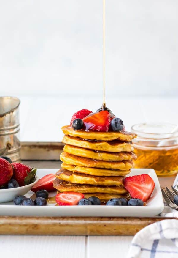 Fluffy low carb coconut flour pancakes! Light, tender pancakes made with coconut flour. High protein and easy to freeze for healthy breakfasts. Add banana, lemon, or any of your favorite toppings!
