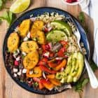 Nourishing Cuban Black Beans and Rice Bowls with baked plantains (tostones), roasted vegetables, and avocado. Packed with authentic Cuban flavors and ingredients. A healthy, filling, all-in-one recipe that's vegan and gluten free!