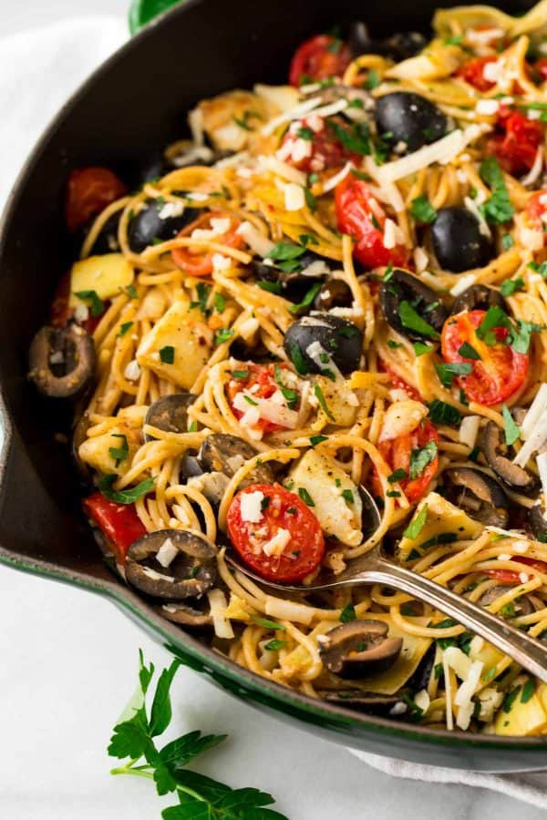Mediterranean Pasta with artichokes, olives, tomato, garlic, and lemon. Fast and fresh for weeknight dinners!