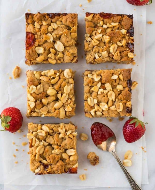 Healthy Strawberry Jam Bars made with whole wheat flour, peanut butter, and strawberry jam. The whole family will love them!