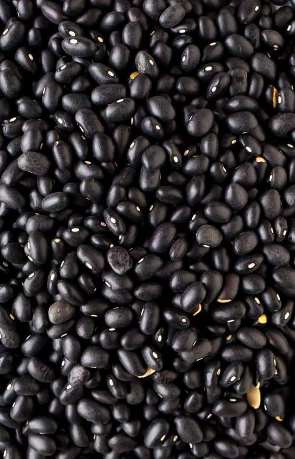 Dried black beans, picked through and ready for the pressure cooker.