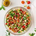 Italian Farro Salad with feta, fresh tomatoes, veggies, and a bright red wine vinaigrette. Delicious, filling vegetarian recipe that's perfect for healthy meal prep, light lunches, or a side dish with dinner. Tastes great leftover and at room temperature, so it's a perfect potluck and barbecue side dish recipe too!