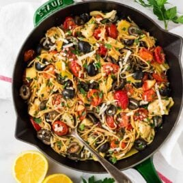 A skillet of Mediterranean pasta with olives and tomatoes