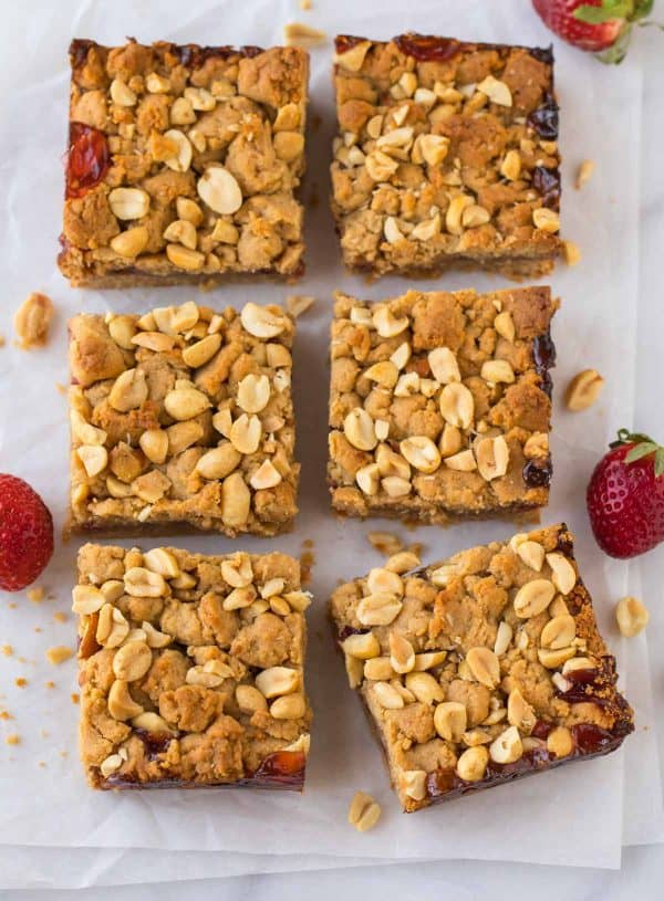 Chopped salted peanuts are sprinkled on top of these easy whole grain Strawberry Jam Bars for a salty-sweet crunch.
