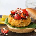 Mediterranean Quinoa Burger. Easy, healthy and protein-packed veggie burger recipe! Made with chickpea, feta, sun-dried tomatoes and herbs, this filling vegetarian recipe is packed with flavor.