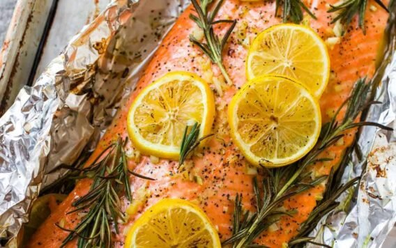 Easy Baked Salmon in Foil with Garlic, Lemon, and Herbs. One of the best simple, healthy recipes. Turns out perfectly every time!