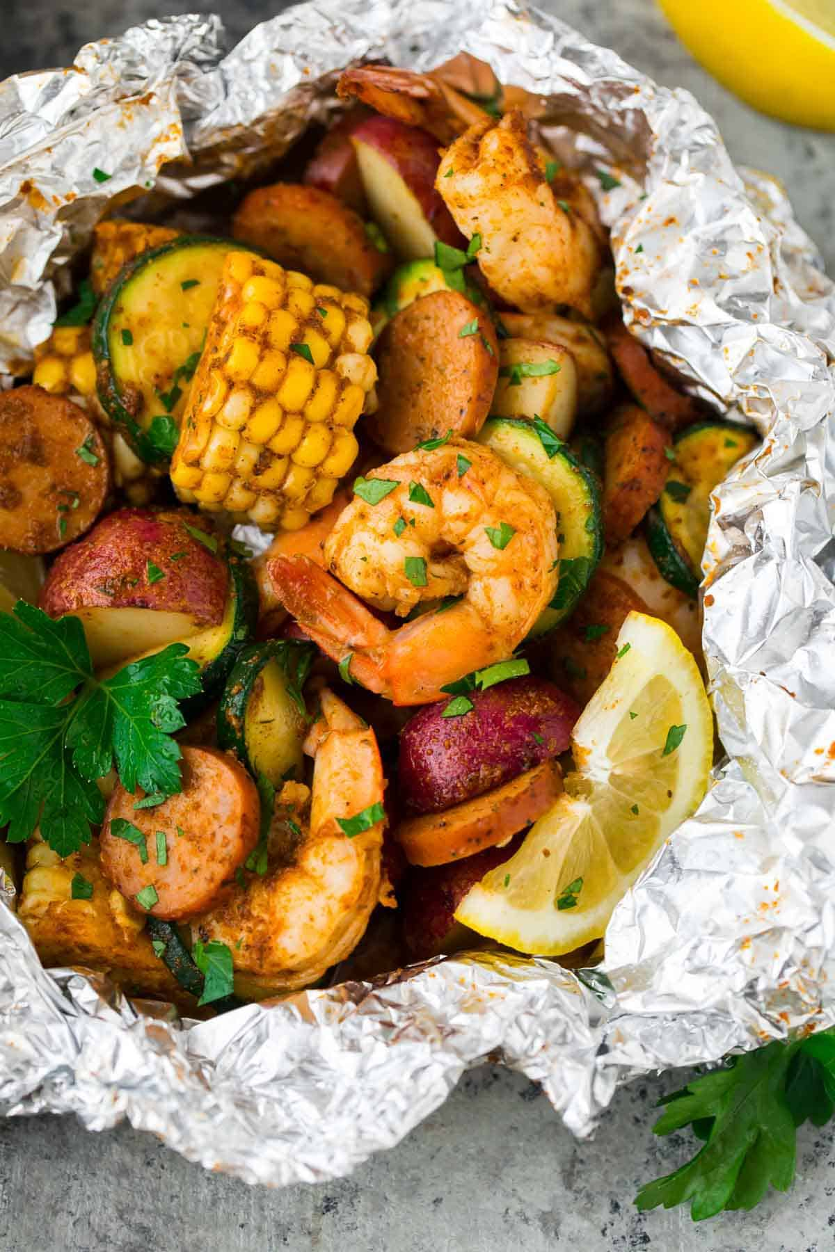 creole shrimp, sausage, and vegetables in a foil packet