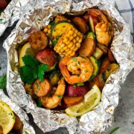 Cajun Shrimp Boil Foil Packets with sausage. Easy recipe that can be made in the oven or on the grill! Perfect for a fast, healthy dinner.