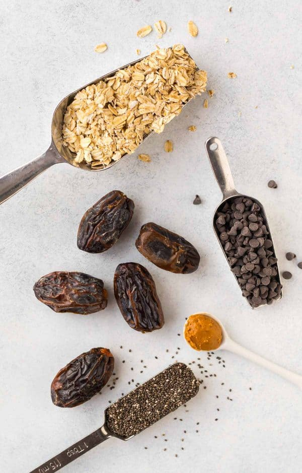 No Bake Chocolate Peanut Butter Protein Balls with dates, chia seeds, oatmeal, and penut butter.