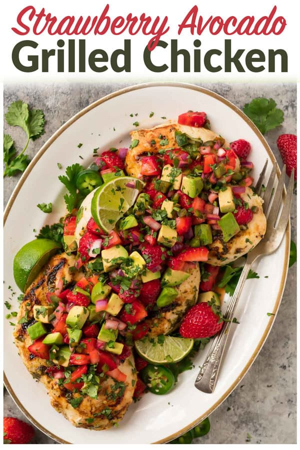 Cilantro Lime Strawberry Chicken with Avocado. A healthy, fresh meal! Juicy grilled chicken in a cilantro lime marinade, topped with fresh strawberry salsa and avocado. Whole30, Paleo, and gluten free. #paleo #whole30 #whole30chicken #chicken #grilledchicken #strawberries #avocado #salsa #grilling #healthy