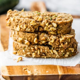 The BEST Vegan Zucchini Bread recipe! Super moist, easy, and healthy vegan zucchini bread. NO SUGAR, naturally sweetened with applesauce, and can be made gluten free. The perfect healthy breakfast or snack for busy families. Add chocolate or any of your favorite mix-ins!