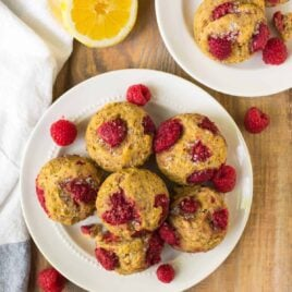 Healthy Raspberry Muffins. Moist and DELICIOUS! Easy homemade recipe for lemon raspberry muffins that are whole wheat, naturally sweetened, and made with Greek yogurt. Use fresh or frozen raspberries or swap in any of your other favorite summer fruits. Great for healthy breakfasts and healthy snacks!