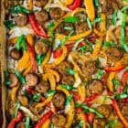 Easy Italian Sausage and Peppers in the Oven. A flavorful, healthy all-in-one dinner! Use to top sandwiches, in pasta, or serve over rice. Great for family dinners or for a crowd!