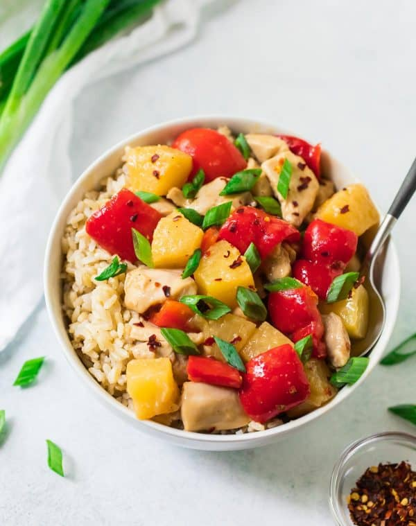 A bowl of pineapple chicken with vegetables